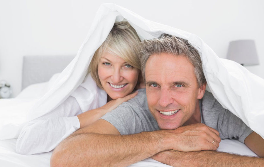 Hormone Replacement Therapy Cost Per Month Happy Older Couple Under the Blanket