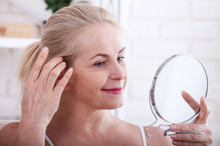 How Long Does it Take for Sermorelin to Work Older Woman Looking at the Mirror